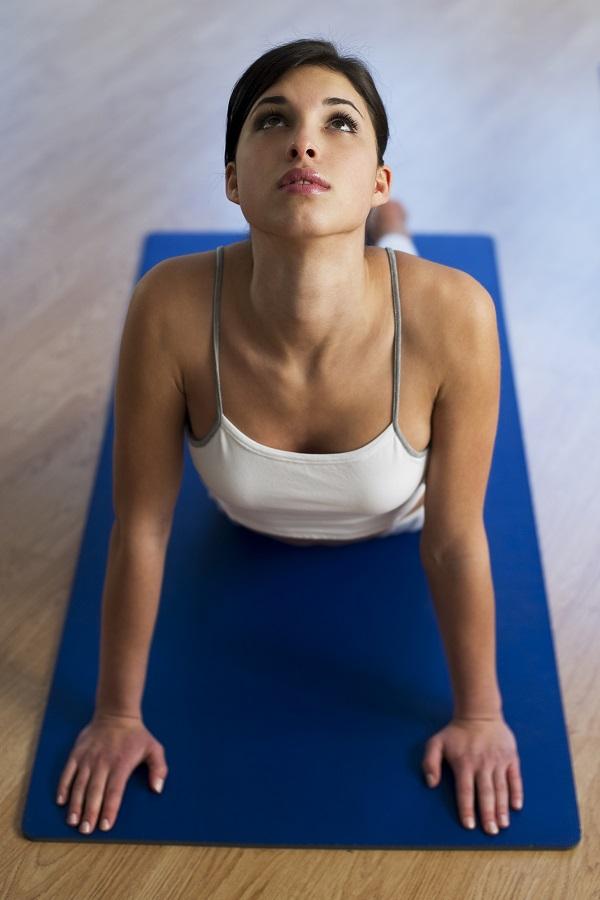 yogalyingonmatposing